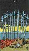 Minor Arcana Ten of Swords, depicting a pierced figure with swords