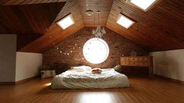 master bedroom below sloping ceiling