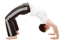 a person performing yoga back bend